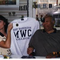 Dr. Farmer in the Bookstore with an MWC Sweatshirt